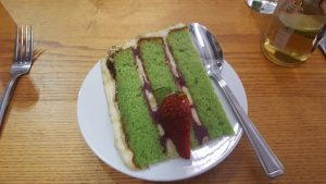 isea eating Matcha green tea, raspberry and Jasmine cake