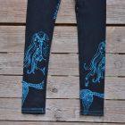 Printed leggings in black with mermaids in teal