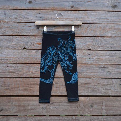Kid's printed leggings in black/teal