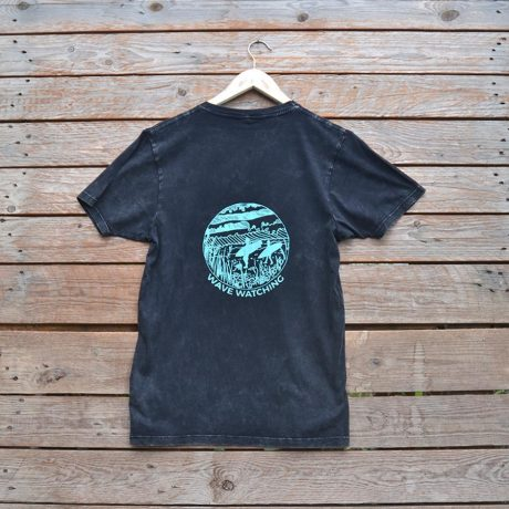 Distressed black t-shirt with wave watching design in aqua ink